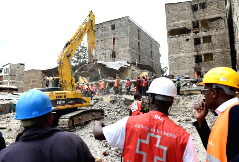 NAIROBI, May 5, 2016 - Rescuers work on pulling a female survivor out of the Huruma building that collapsed six days before in Nairobi, Kenya, May 5, 2016. Kenya's rescuers have pulled out seven more ...