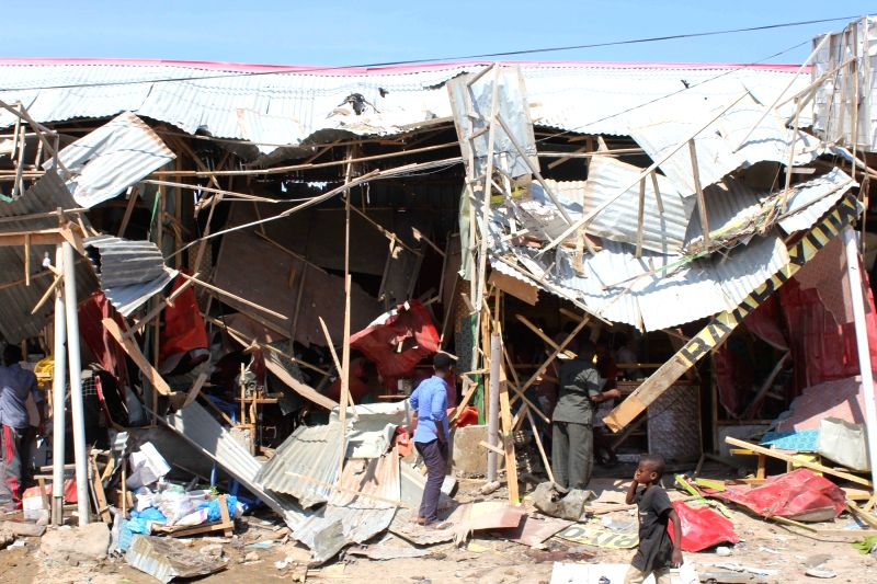 NAIROBI, Nov. 26, 2018 (Xinhua) -- Photo taken on Nov. 26, 2018 shows the site of a car bomb in Mogadishu, capital of Somalia. At least 10 people were killed and six others injured in a car bomb explosion in a busy market in Mogadishu's Wadajir distr