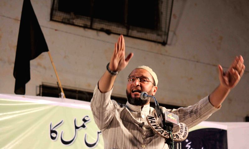 MIM president Asaduddin Owaisi addresses a public rally in Nalgonda of Telangana.