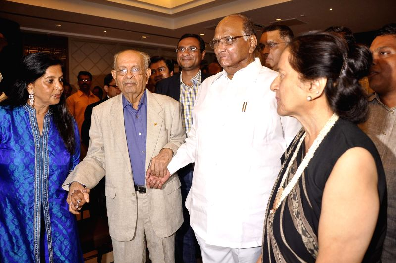 Nana Chudasama, World Chairman, Giants International with his wife Munira Chudasama and Nationalist Congress Party (NCP) Chief Sharad Pawar during his 81st birthday celebrations in Mumbai on June 17,