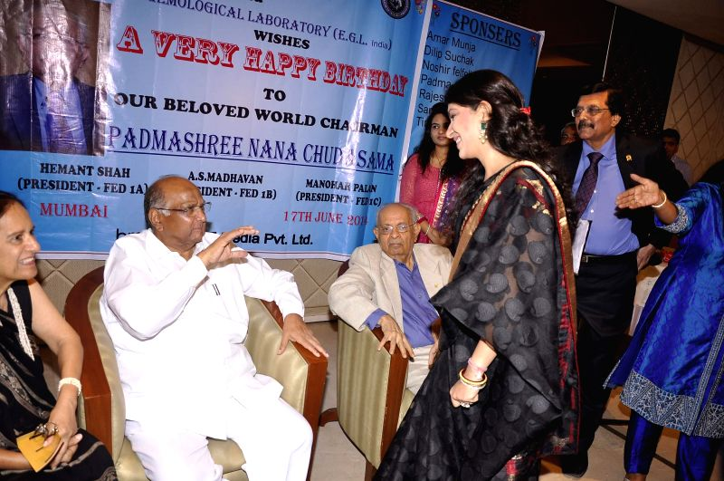 Nana Chudasama, World Chairman, Giants International with his wife Munira Chudasama, daughter fashion designer Shaina NC and Nationalist Congress Party during his 81st birthday celebrations in Mumbai