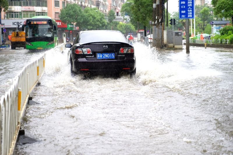 NANCHANG, June 2, 2016 - A car passes on a waterlogged street in Nanchang, capital of east China's Jiangxi Province, June 2, 2016. Heavy rainfall hit Nanchang Thursday, and water logging hindered the ...