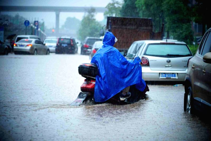 NANCHANG, June 2, 2016 - A resident riding an electric bicycle passes on a waterlogged road in Nanchang, capital of east China's Jiangxi Province, June 2, 2016. Heavy rainfall hit Nanchang Thursday, ...