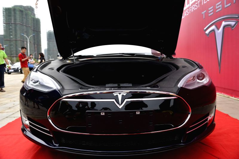 Photo taken on May 17, 2014 shows a Tesla Model S electronic car at an activity in Nanchang, capital of east China's Jiangxi Province. Model S made its debut in ...