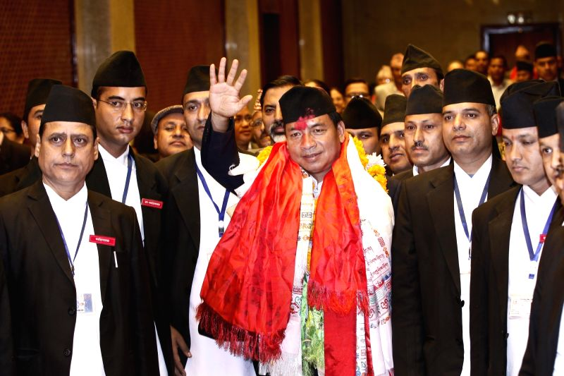 Nanda Bahadur Pun (C), standing committee member of the United Communist Party of Nepal (Maoist), waves his hand after winning the election of Nepal's vice ...