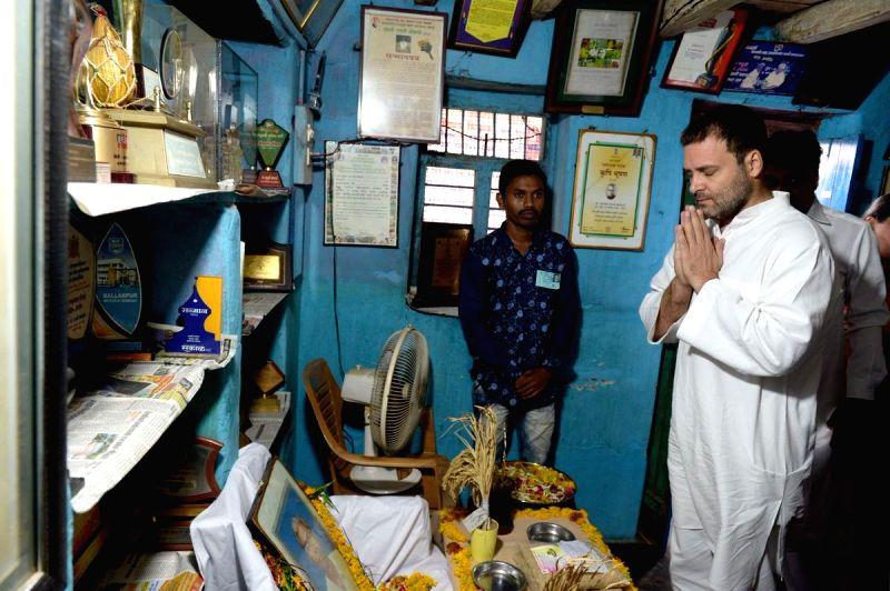 :Nanded: Congress President Rahul Gandhi during his visit to the residence of rice innovator Late Dadaji Ramaji Khobragade, in Maharashtra's Nanded on June 13, 2018. (Photo: ...