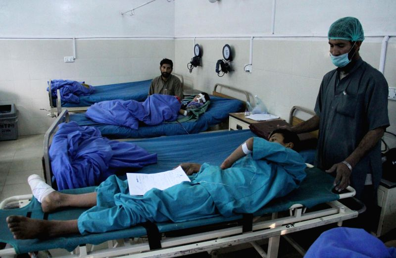 Afghan wounded people receive medical treatment at a hospital in Nangarhar province, Afghanistan, Dec. 14, 2014. Six students were injured as a bomb blast rocked eastern Jalalabad city the