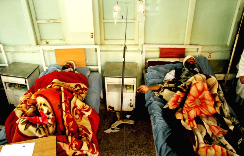 Nangarhar (Afghanistan): Afghan wounded men receive treatment at a hospital following a blast inside a mosque in Nangarhar province in eastern Afghanistan, Nov. 28, 2014. A bomb exploded inside a ...