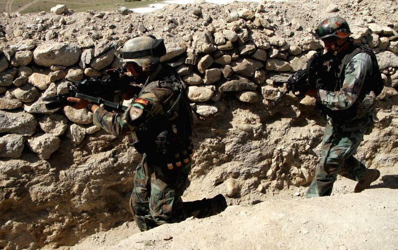 NANGARHAR (AFGHANISTAN), April 14, 2017 Afghan army soldiers are deployed to Achin district of Nangarhar province, Afghanistan, after the U.S. military dropped a GBU-43 or Massive ...