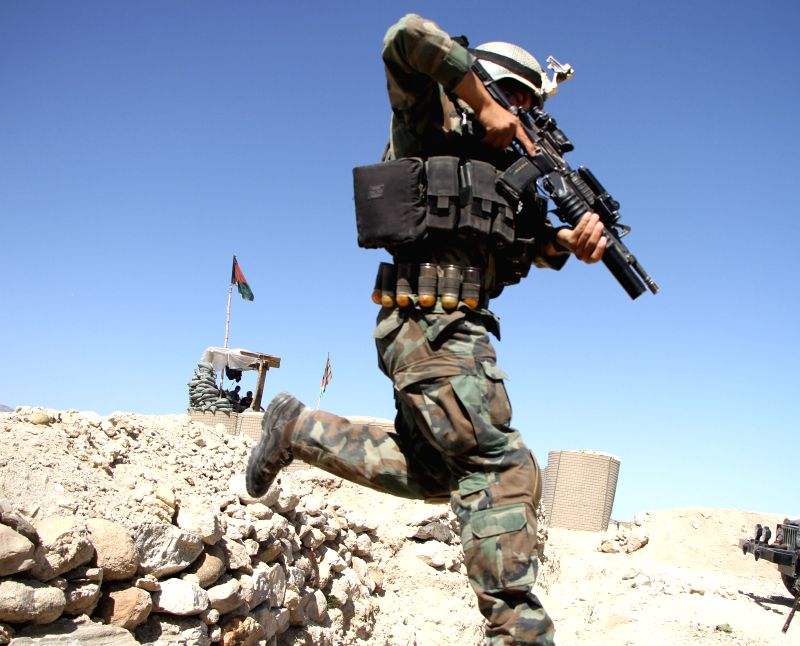 NANGARHAR (AFGHANISTAN), April 14, 2017 An Afghan army soldier is deployed to Achin district of Nangarhar province, Afghanistan, after the U.S. military dropped a GBU-43 or Massive ...