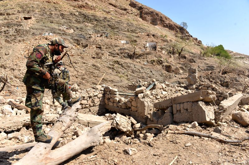 NANGARHAR, April 30, 2017 - An Afghan army soldier stands at the site of a U.S. bombing in Achin district of Nangarhar province, Afghanistan, April 28, 2017. On April 13, the U.S. forces in ...