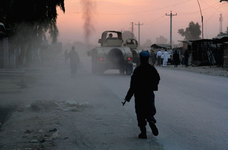 Afghan soldiers walk at the site of an attack in Nangarhar province in eastern Afghanistan on Aug. 30, 2014. Casualties were feared as a suicide car bomb ...