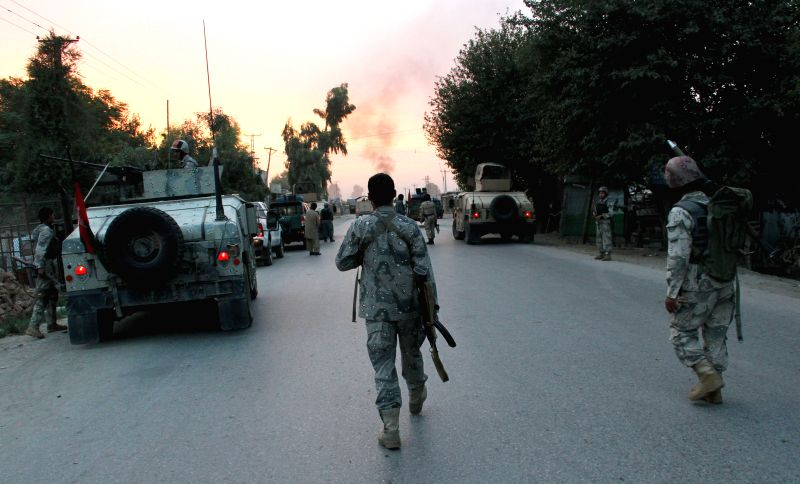 Afghan soldiers patrol at the site of an attack in Nangarhar province in eastern Afghanistan on Aug. 30, 2014. Casualties were feared as a suicide car bomb ...