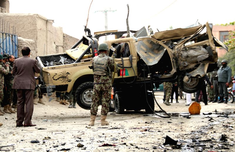 Afghan security forces transfer a destroyed military vehicle following a blast  in Nangarhar province in east Afghanistan on Dec. 21, 2014. Earlier on Sunday, one