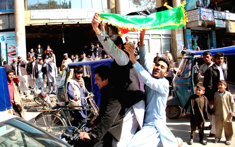 People celebrate the Afghan national cricket team's victory in Nangarhar province, Afghanistan, Feb. 26, 2015. The Afghan National Cricket Team beat Scotland on ...