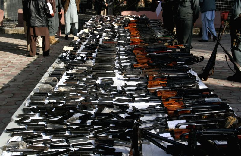 Weapons seized by Afghan security forces during an operation are displayed in Nangarhar province, east Afghanistan, Jan. 18, 2015.