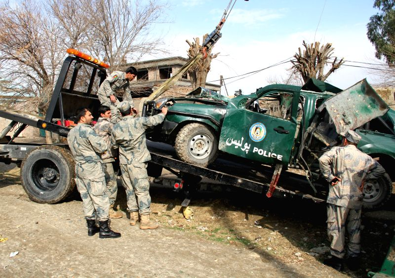 Afghan policemen inspect the site of blast in Jalalabad city, capital of Nangarhar province, east Afghanistan, Jan. 24, 2015. A bomb blast presumably organized by