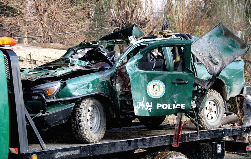 Photo taken on Jan. 24, 2015 shows a destroyed police vehicle following a blast in Jalalabad city, capital of Nangarhar province, east Afghanistan. A bomb blast ..