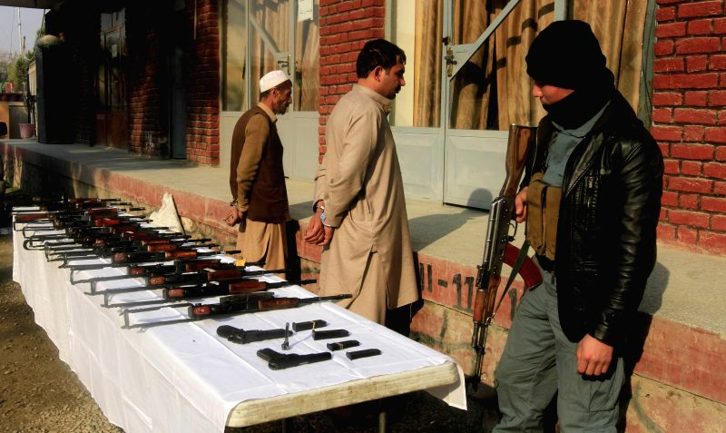 Two men of Taliban stand handcuffed after being captured with weapons during an operation by Afghan policemen in Nangarhar province, eastern Afghanistan, on Jan. ..