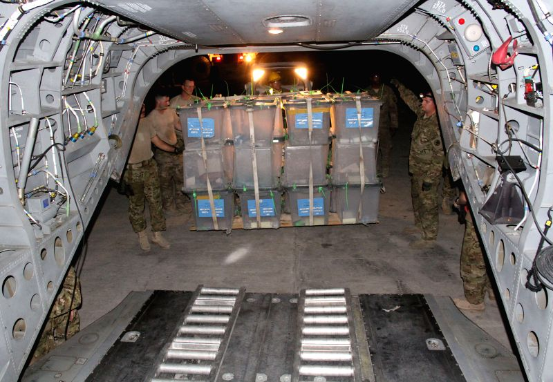 U.S. soldiers load ballot boxes onto a plane during ballots transfer to Kabul for an audit in Nangarhar, Afghanistan, July 23, 2014. Afghanistan started to audit .