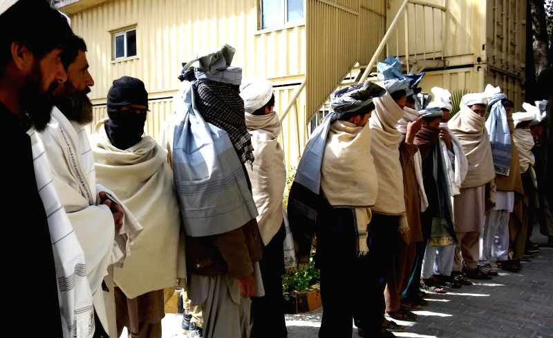 Taliban fighters attend a surrender ceremony in Nangarhar province, eastern Afghanistan, March 12, 2015. A total of 16 armed militants laid down arms and gave up ...