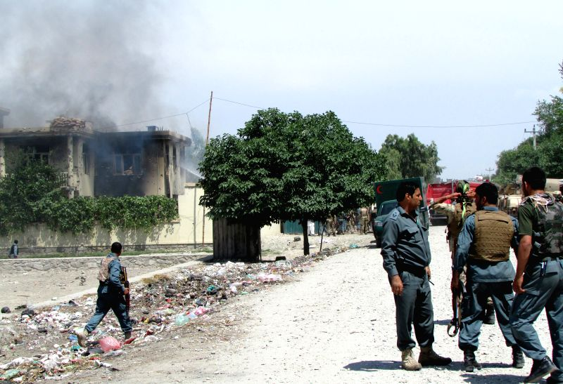 Smoke rises from a building occupied by Taliban militants in Nangarhar Province, east Afghanistan, May 12, 2014. Seven people were killed as Taliban members ...