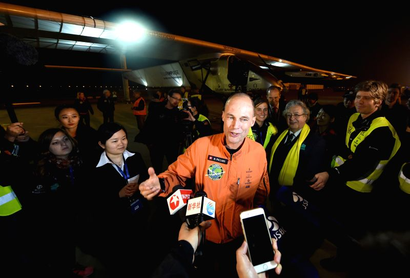 Pilot Bertrand Piccard is interviewed as he arrives at Nanjing Lukou International Airport by flying Swiss-made solar-powered plane Solar Impluse 2 in Nanjing, ...