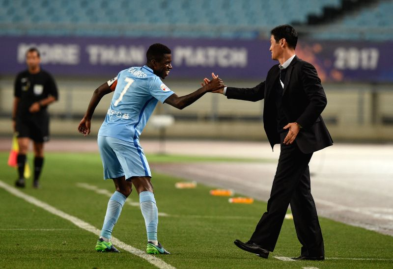 NANJING, April 25, 2017 - Ramires (L) of China's Jiangsu FC celebrates after scoring with the head coach Choi Yong-soo during the AFC Champions League  Group H football match between China's Jiangsu ...