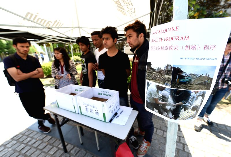 Nepalese students ask for donations to help the people affected by Nepal earthquake, at Nanjing University of Aeronautics and Astronautics, east China's Jiangsu ... - Kamal Singh Bam