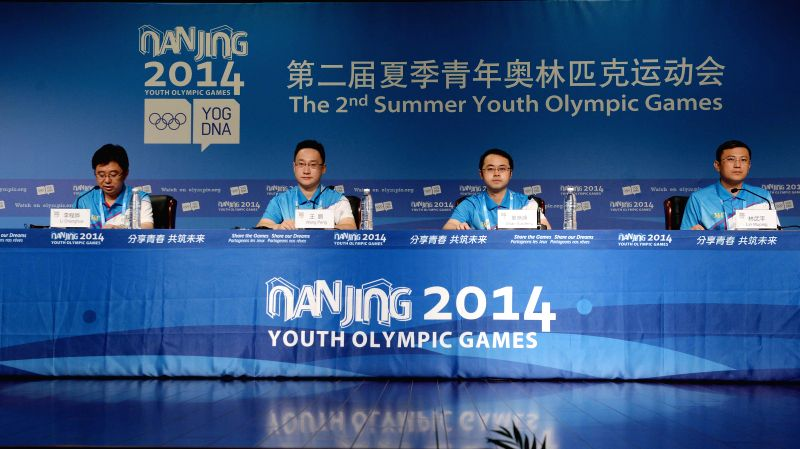The press conference on volunteer services is held in the Press Conference Room prior to the Nanjing 2014 Youth Olympic Games in Nanjing, capital of east China's ..