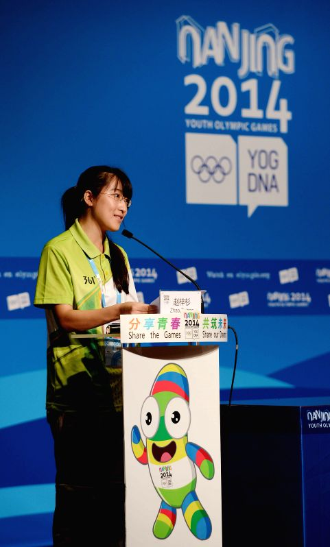 Volunteer representative Zhao Zishan speaks during the press conference on volunteer services held in the Press Conference Room prior to the Nanjing 2014 Youth ...