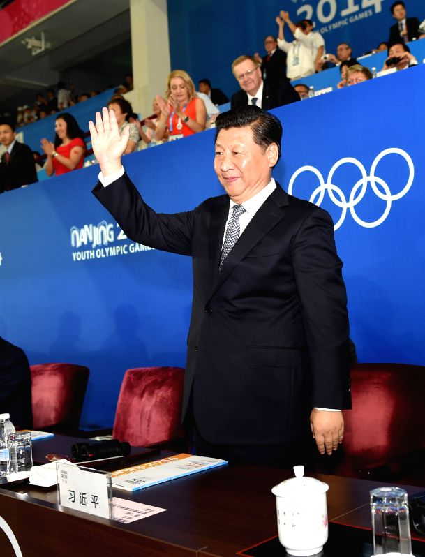 Chinese President Xi Jinping attends the opening ceremony of the Nanjing 2014 Youth Olympic Games in Nanjing, capital of east China's Jiangsu Province, Aug. 16, ...