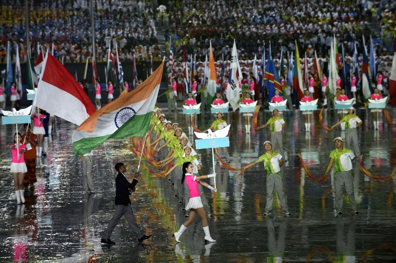 The flag bearer of India delegation parades into the stadium during the opening ceremony of Nanjing 2014 Youth Olympic Games in Nanjing, capital of east China's ...