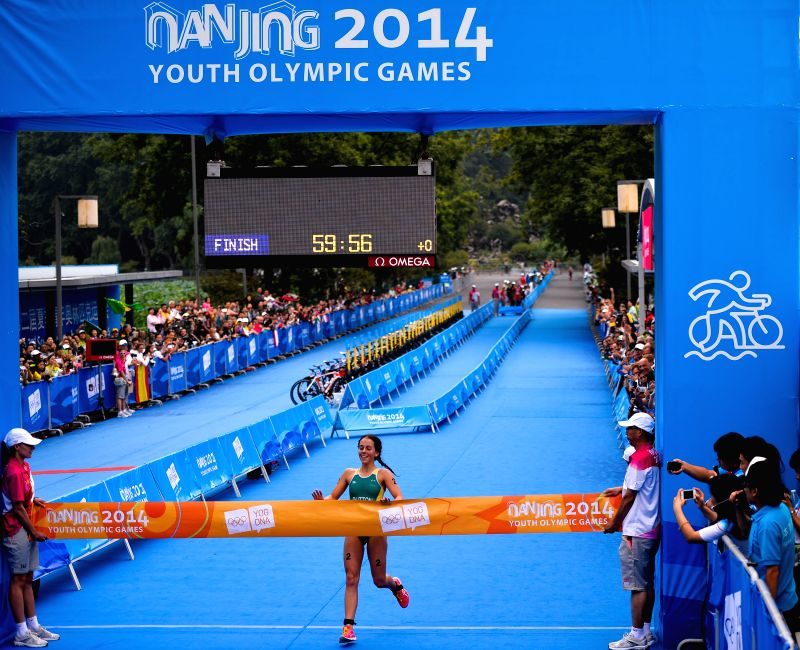 Brittany Dutton of Australia crosses the finish line during the women's triathlon final at the 2nd Summer Youth Olympic Games (YOG) held at the Xuanwu Lake ...