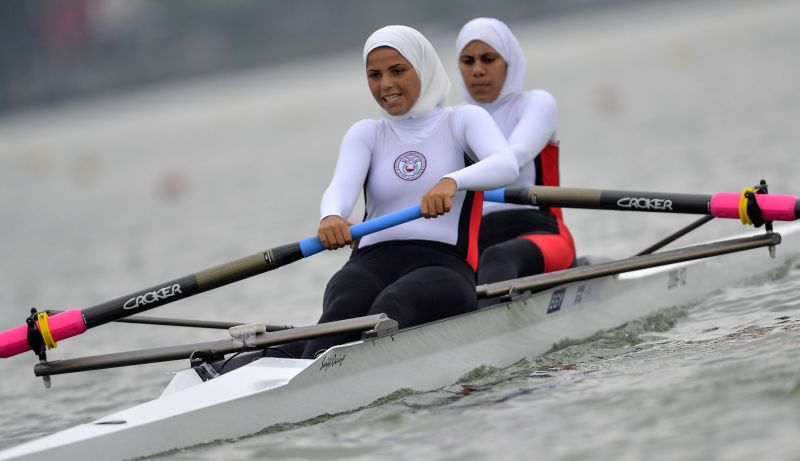 Basma Mahmoud and Alaa Mohamed (R) of Egypt compete during the Junior Women's Pair Heat of rowing event at Nanjing 2014 Youth Olympic Games in Nanjing, capital of ..