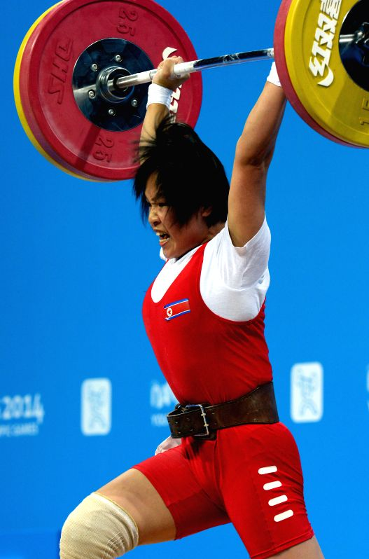 Jong Chun Hui of Democratic People's Republic of Korea competes during the women's 53kg match of weightlifting event at the Nanjing 2014 Youth Olympic Games in ...