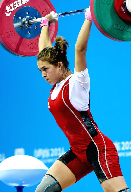 Nouha Landoulst of Tunisia competes during the women's 53kg match of weightlifting event at the Nanjing 2014 Youth Olympic Games in Nanjing, capital of east ...