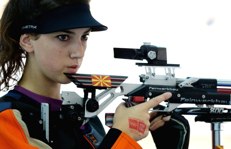 Ana Ivanovska of Macedonia competes in the women's 10m Air Rifle qualification match of shooting event at the Nanjing 2014 Youth Olympic Games in Nanjing, capital ..