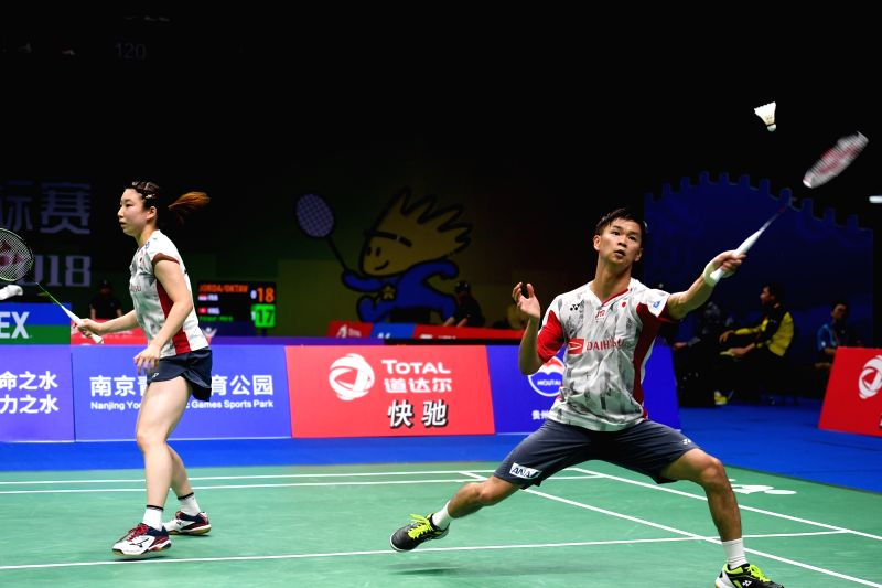 NANJING, Aug. 2, 2018 - Yuta Watanabe (R) and Arisa Higashino of Japan compete during the mixed doubles third round match against Wang Yilyu and Huang Dongping of China at the BWF (Badminton World ...