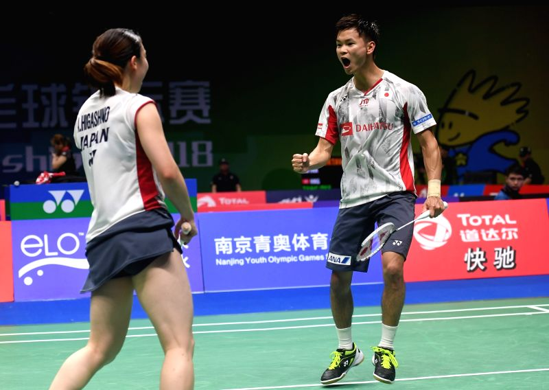 NANJING, Aug. 2, 2018 - Yuta Watanabe (R) and Arisa Higashino of Japan celebrate during the mixed doubles third round match against Wang Yilyu and Huang Dongping of China at the BWF (Badminton World ...