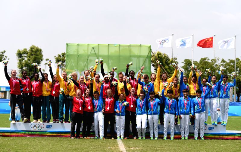 Gold medalists Australia, silver medalists Canada and bronze medalists China pose for a photo during the awarding ceremony of women rugby sevens at Nanjing 2014 ...