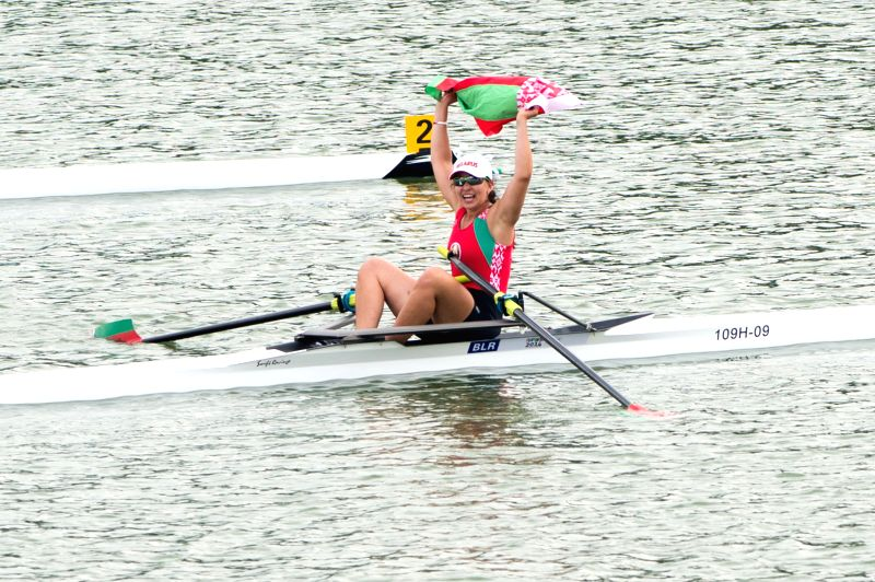Krystsina Staraselets of Belarus celebrates after the Junior Women?s Single Sculls competition at Nanjing 2014 Youth Olympic Games in Nanjing, capital of east ...