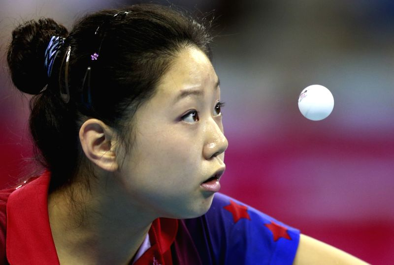 Lily Zhang of United States of America competes during the Bronze Medal Match of Women?s Singles Table Tennis competition at Nanjing 2014 Youth Olympic Games in ...