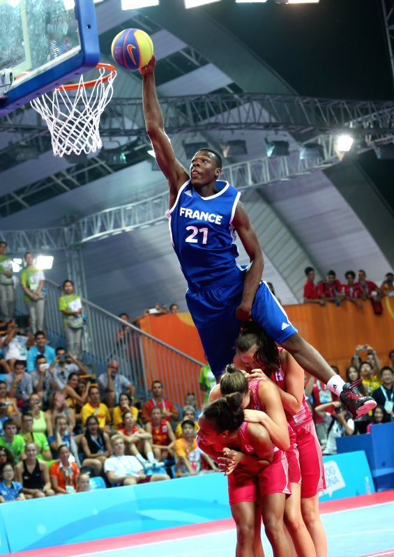 Gold medalist Karim Mouliom (T) of France competes during men's dunk contest final of basketball at the Nanjing 2014  Youth Olympic Games in Nanjing, east China's ..