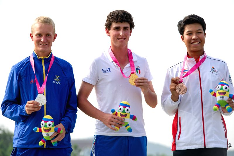 Gold medalist Renato Paratore (C) of Italy, silver medalist Marcus Kinhult(L) of Sweden and bronze medalist Danthai Boonma of Thailand pose on the podium during ...