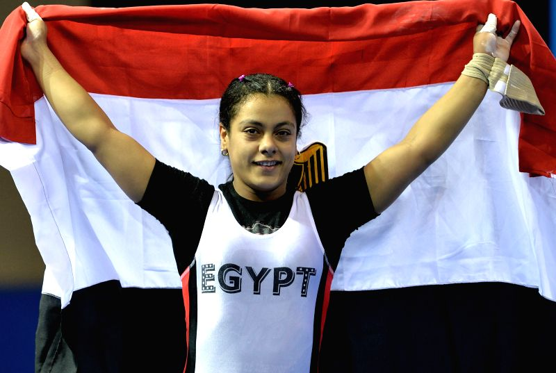 Gold medalist Sara Ahmed of Egypt celebrates the winning after the women's 63-kg weightlifting event at the Nanjing 2014 Youth Olympic Games in Nanjing, east ...
