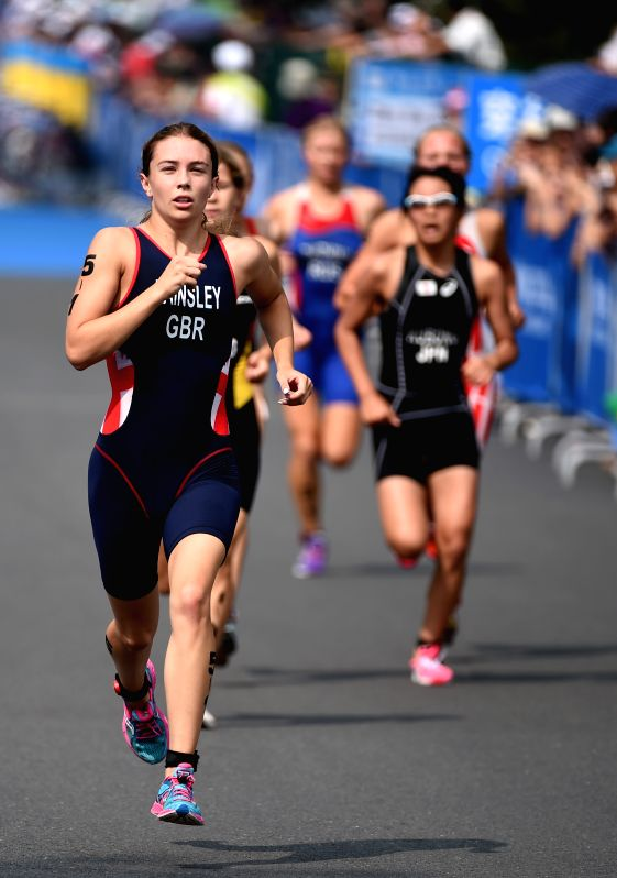 Great Britain's Sian Rainsley (L) of Europe 3 competes during the 4X Mixed Relay's Final of triathlon event at the 2014 Nanjing Youth Olympic Games in Nanjing, east