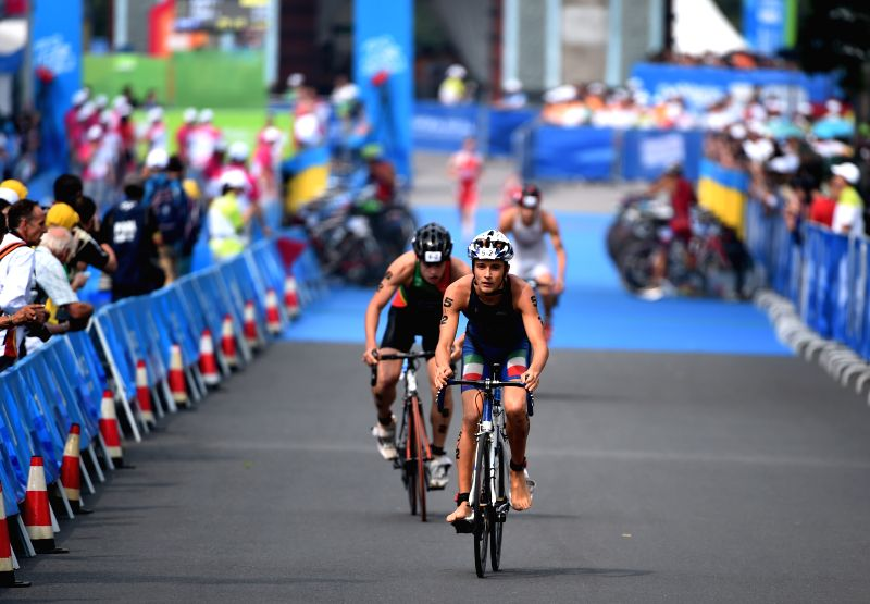 Italy' s Guilio Soldati (F) of Europe 3 competes during the 4X Mixed Relay's Final of triathlon event at the 2014 Nanjing Youth Olympic Games in Nanjing, east ...