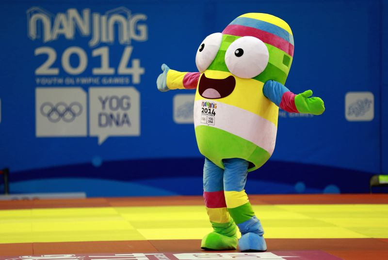 Olympic Mascot Lele dances before the Mixed International Team Contest for Bronze Medal of Judo at the Nanjing 2014 Youth Olympic Games in Nanjing, capital of east .