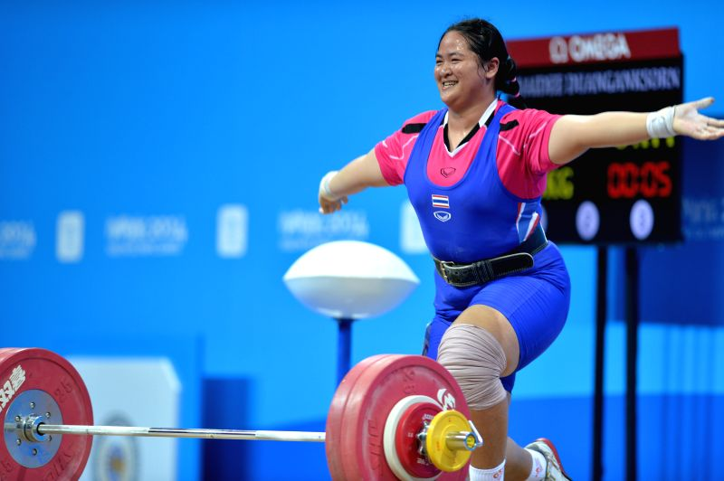 Duanganksorn Chaidee of Thailand celebrates during the Women?s +63kg match of weightlifting event at the Nanjing 2014 Youth Olympic Games in Nanjing, capital of ...